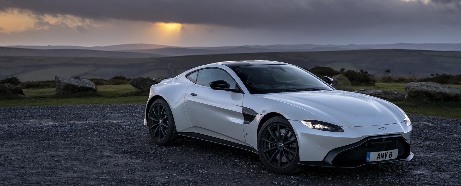 Grey Aston Martin Vantage, parked in sunset