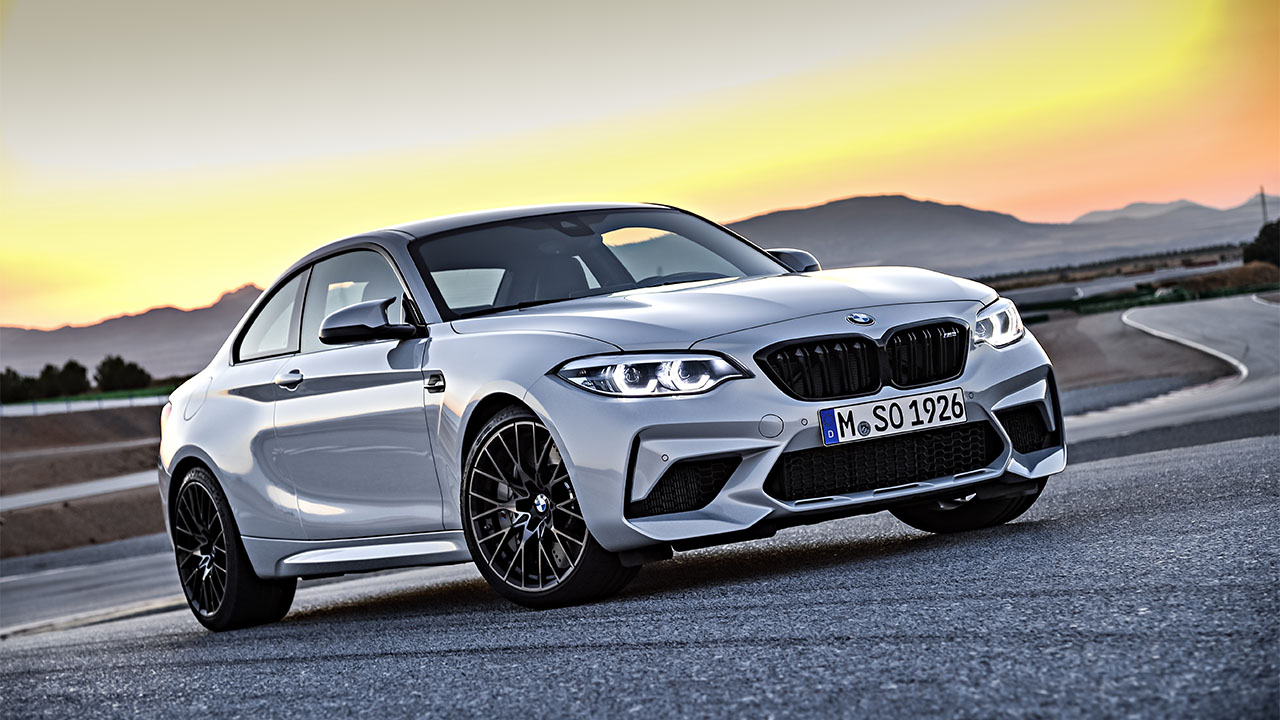 Silver BMW M2 Competition, parked on racing track