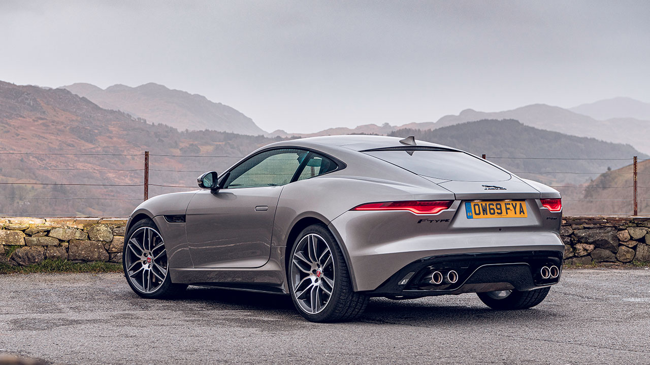 Grey Jaguar F-TYPE, parked in countryside