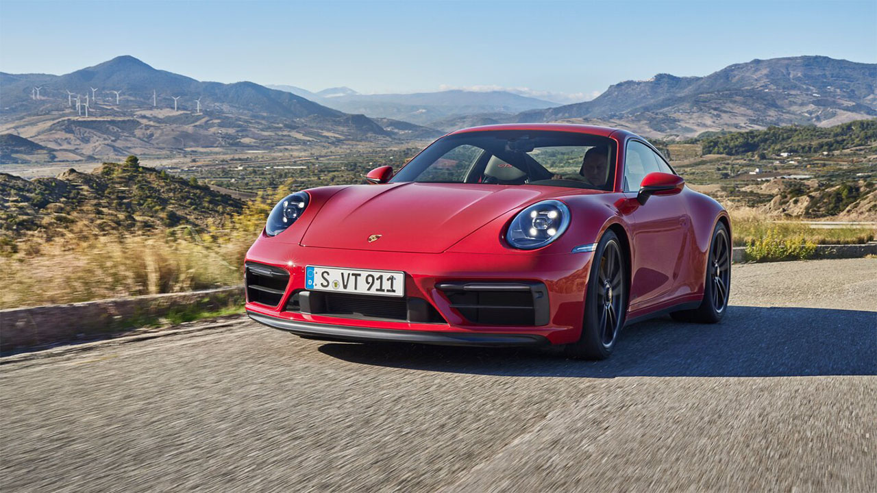 Red Porsche 911, driving in the countryside