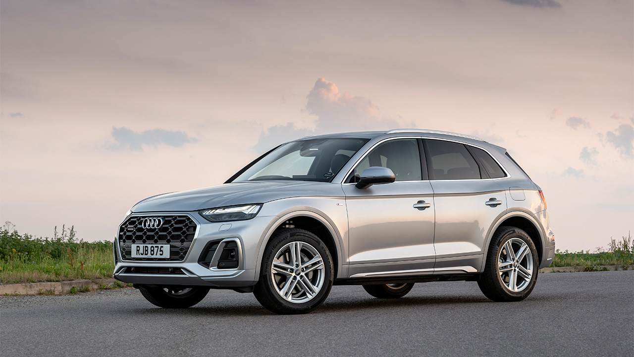Silver Audi Q5, parked in sunset