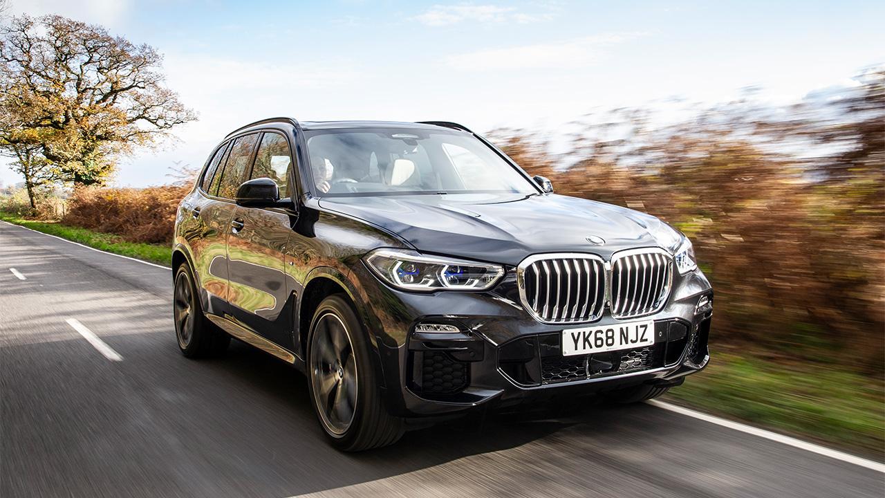 Black BMW X5, driving