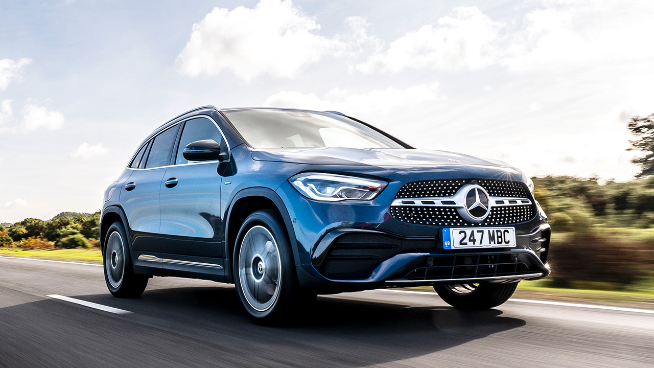 Blue Mercedes-Benz GLA, driving down country road