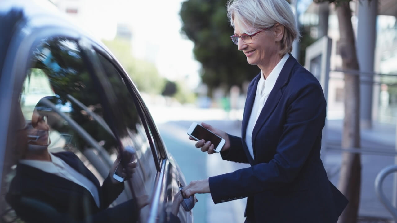 Business Woman Opening Car