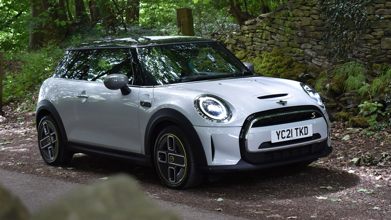MINI Electric, front quarter shot, parked in forestry layby