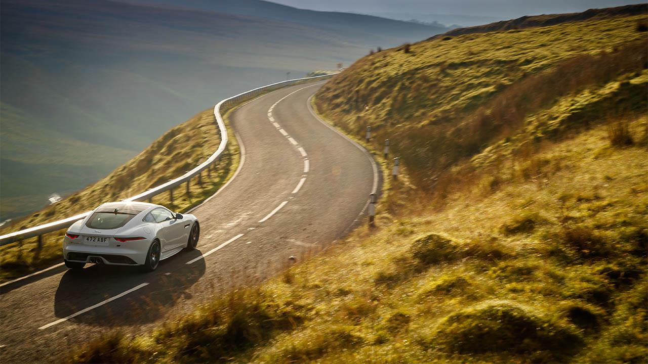 jaguar f-type driving in hills