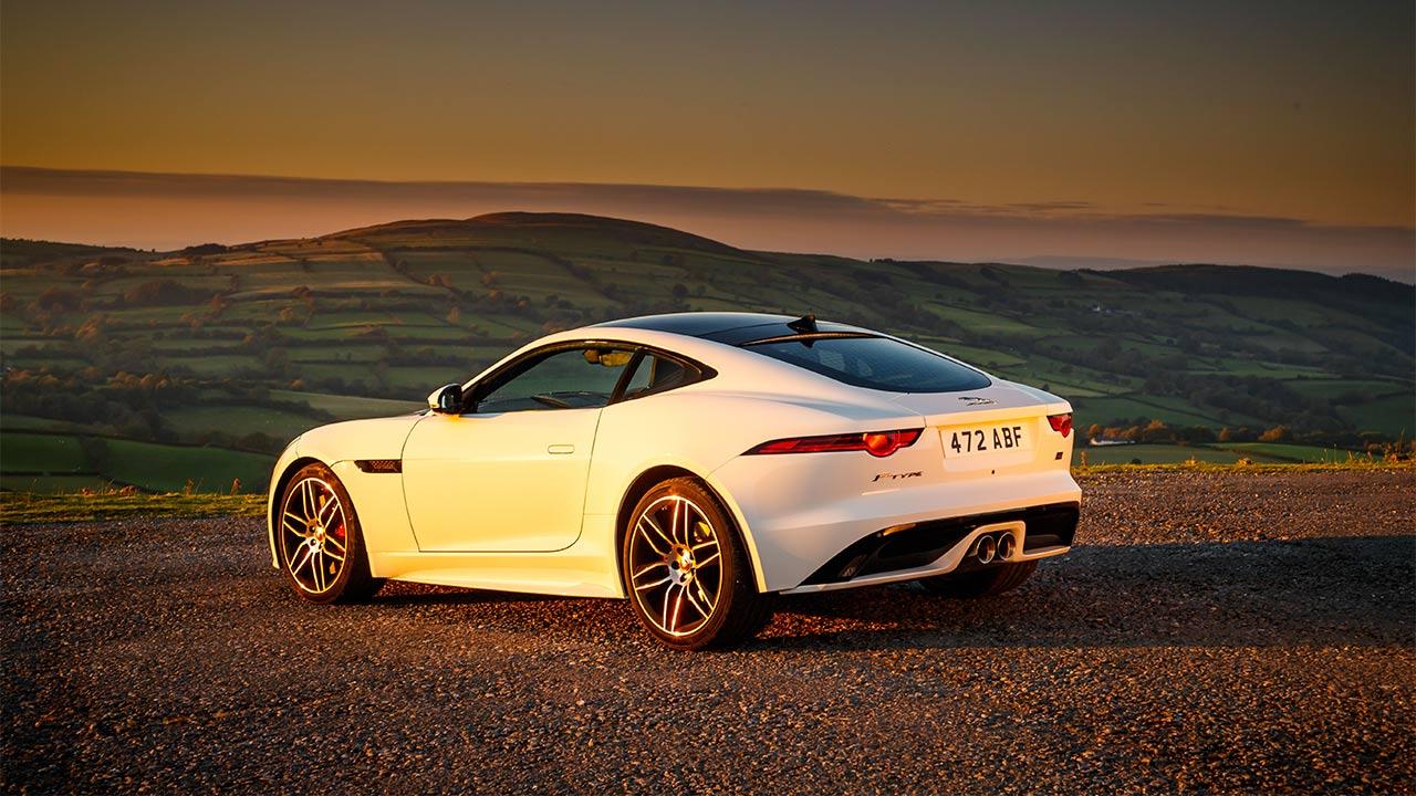 jaguar f-type parked in sunset