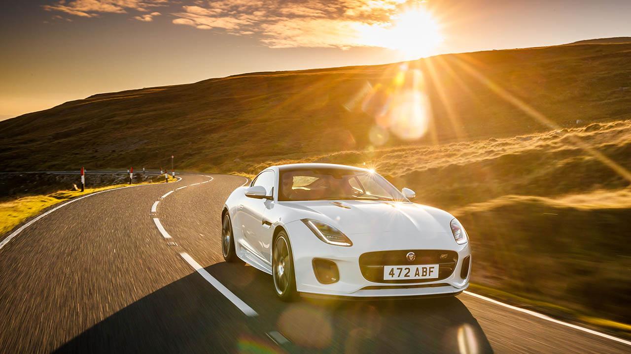 jaguar f-type driving in sunset
