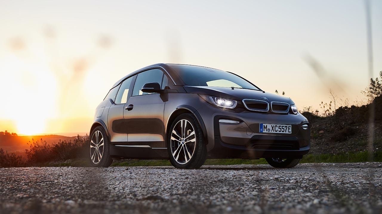 bmw i3s parked in sunset