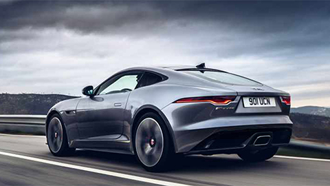 grey jaguar f-type driving