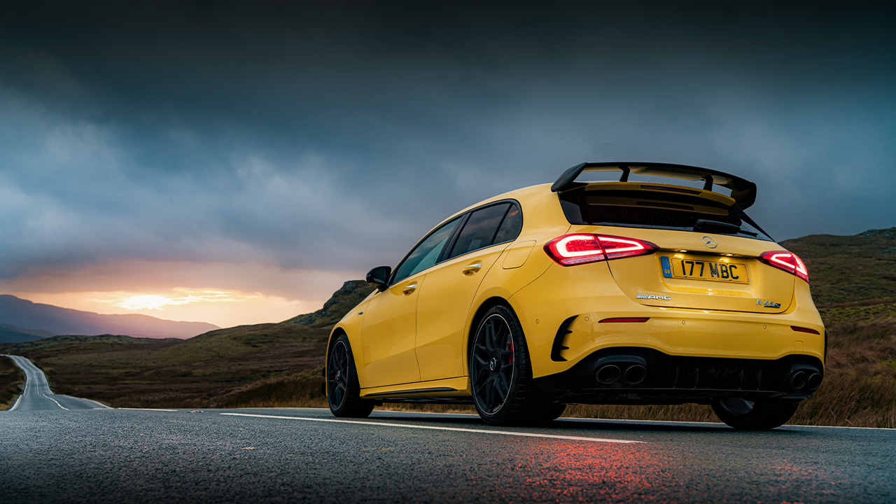 Yellow Mercedes-AMG A-Class, parked