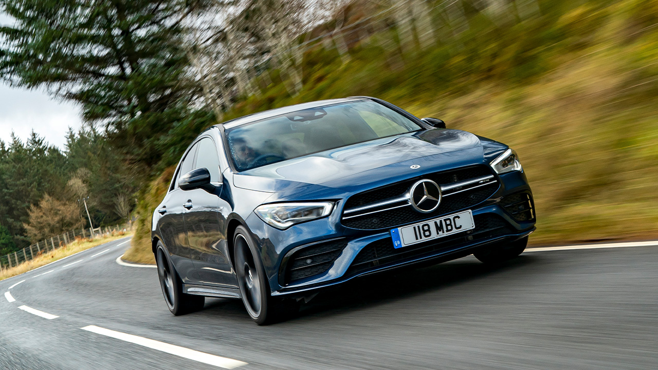 Blue Mercedes-AMG CLA, driving down country road