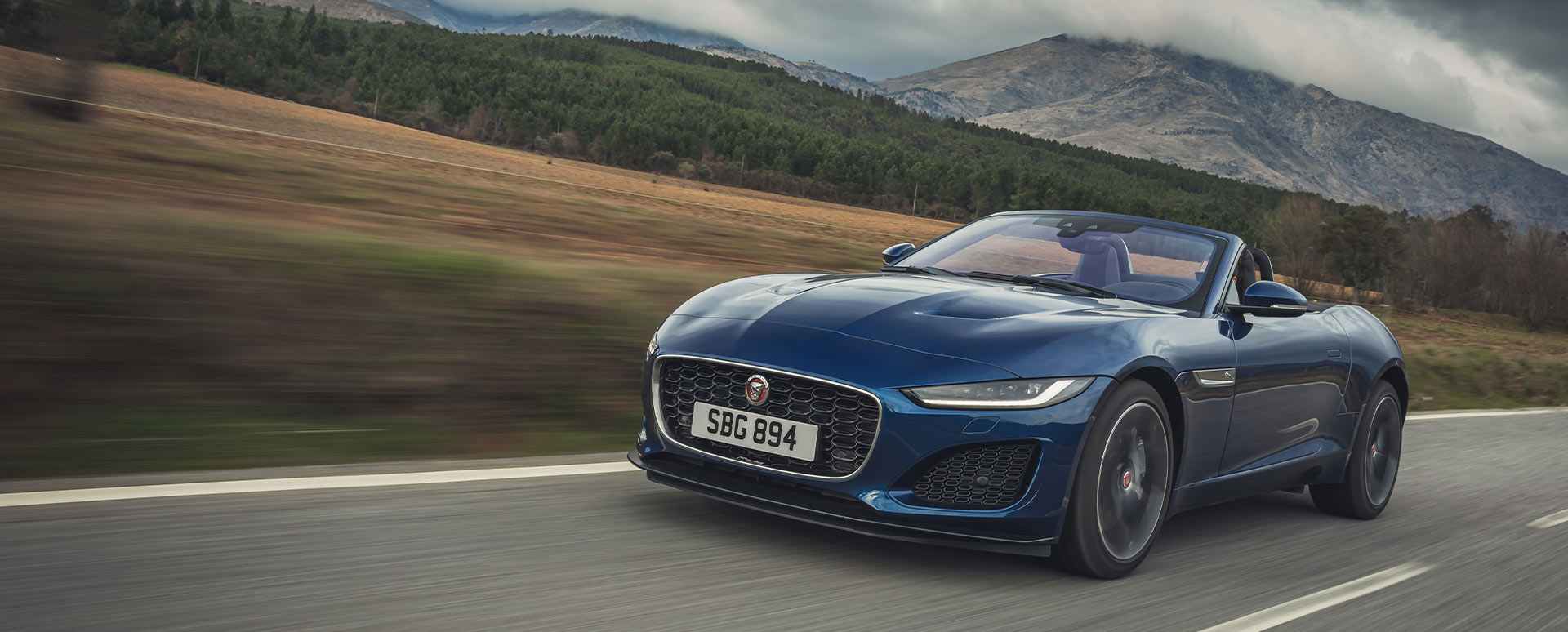 Blue Jaguar F-TYPE Convertible, driving