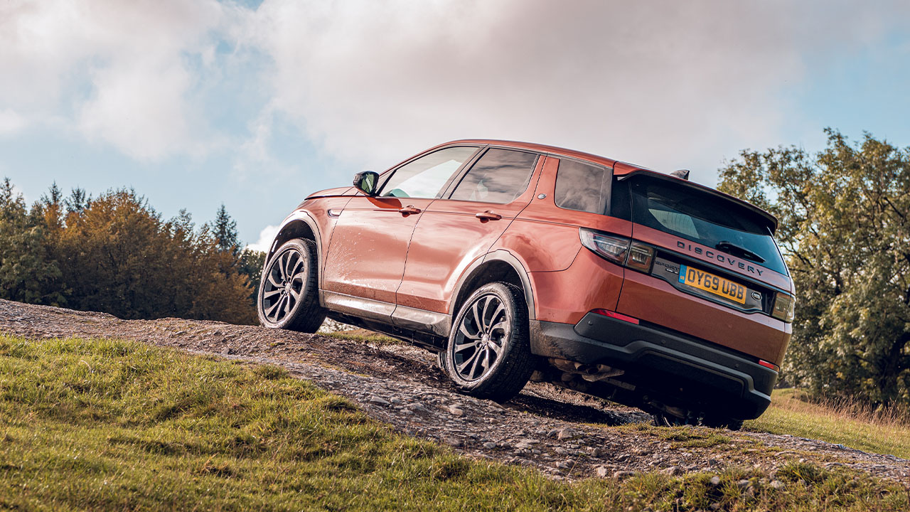 Orange Land Rover Discovery Sport, off-roading incline