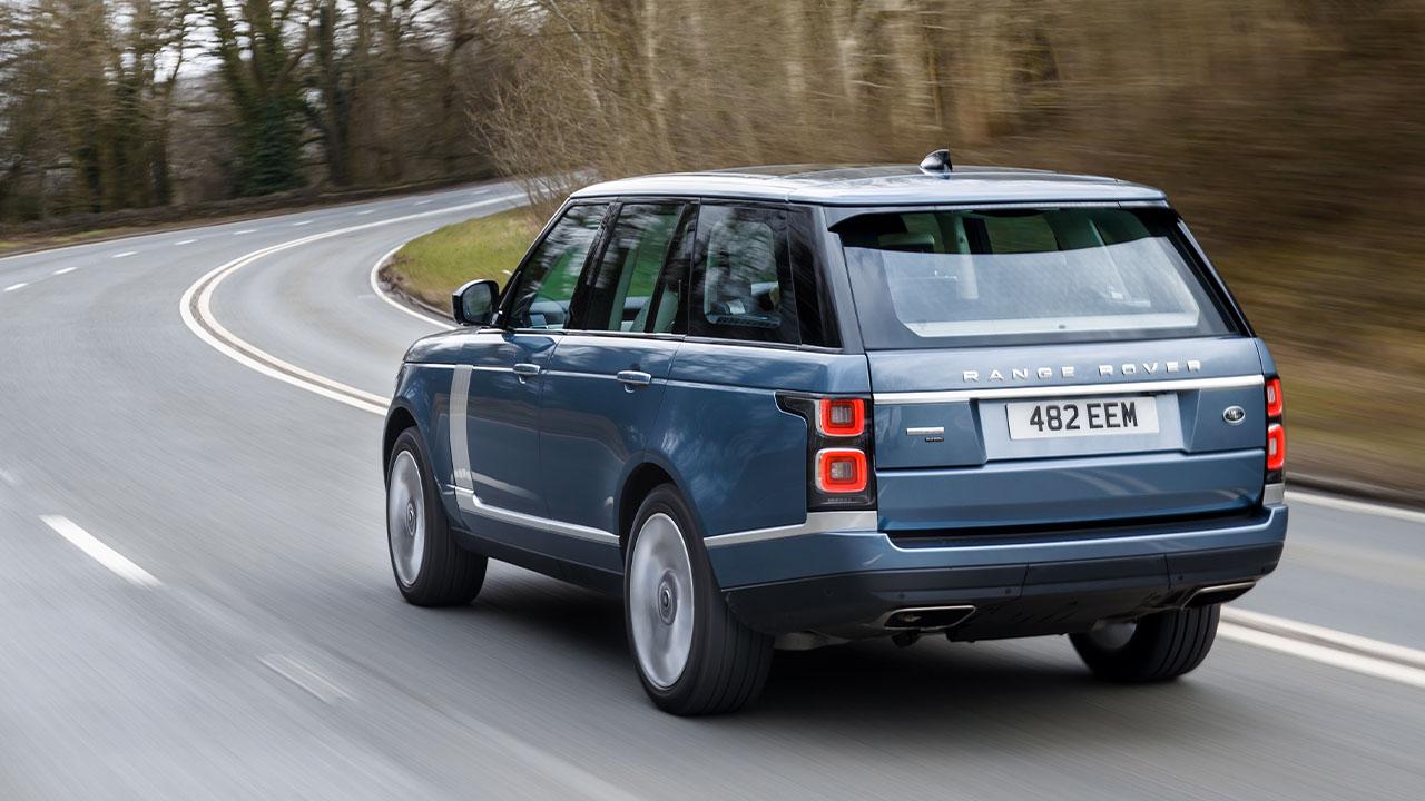 Blue Range Rover, rear driving shot