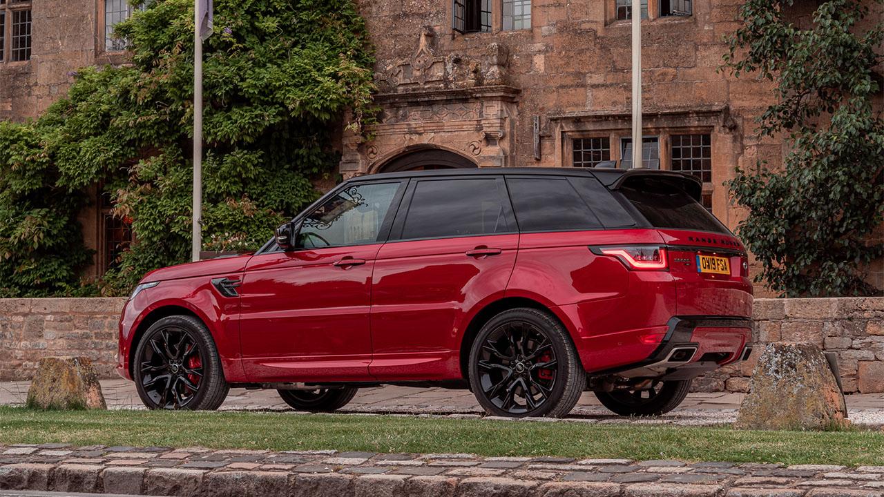 Red Range Rover Sport, parked side shot