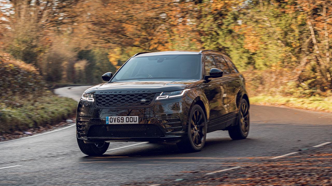 Black Range Rover Velar, driving