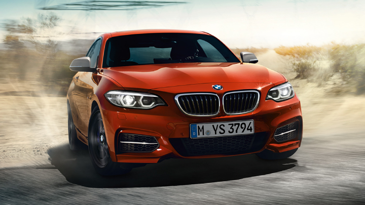 BMW 2 Series Coupe in orange.