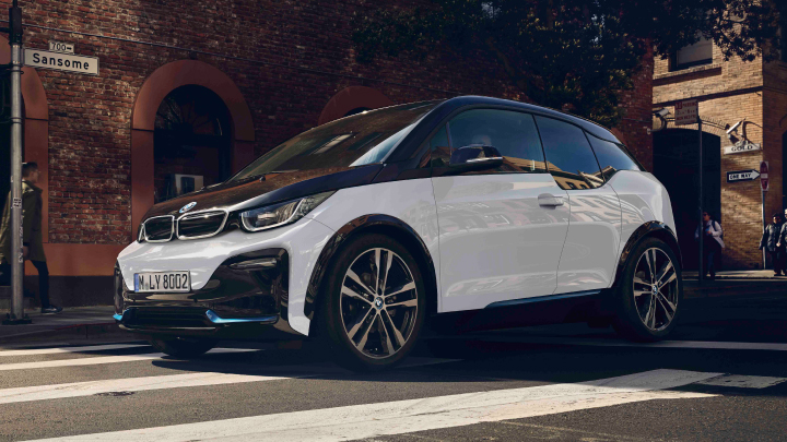 White and black BMW i3 on the road.