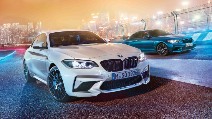 Two BMW M2 Competitions, in white and blue.