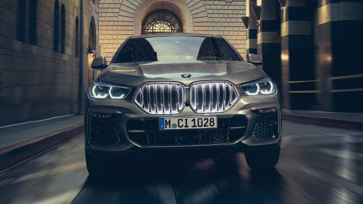 BMW X6 driving on the road.