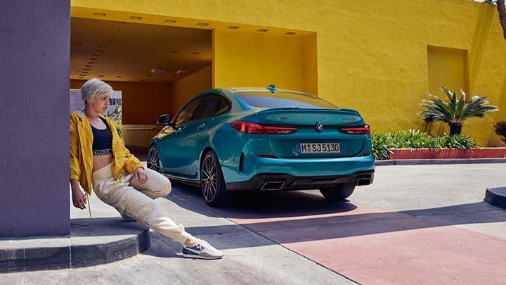bmw 2 series lifestyle shot with yellow buildings in background