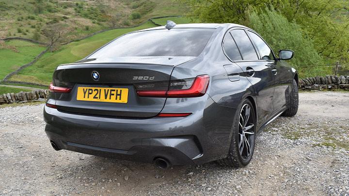 Grey BMW 3 Series, rear, parked