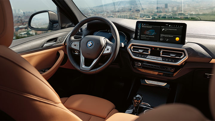 BMW X3, tan interior with 12-inch infotainment screen