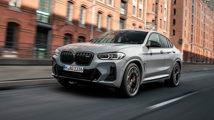 Grey BMW X4, driving in the city