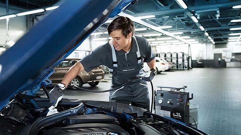 bmw technician performing air conditioning service