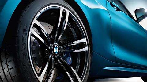 rear quarter shot of bmw m2 rear wheel