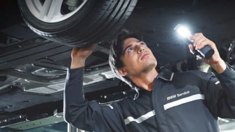 BMW Technician Checking Car