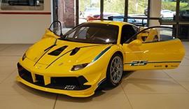 Yellow Ferrari 488 in the showroom.