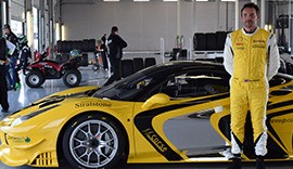 Sam Smeeth stood in front of a yellow Ferrari.