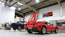 Ferrari's being serviced in the warehouse.