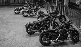 Black and white photograph of Harley Davidsons.