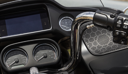 Motorcycle handles, dials and screen.