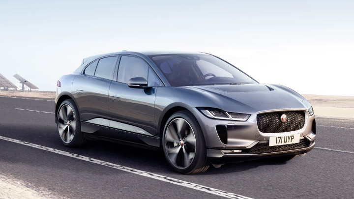 Gre Jaguar I Pace driving on the road.