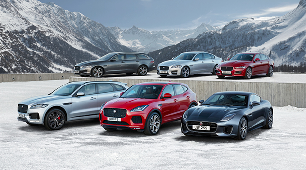 Used Jaguar cars parked in the snow.