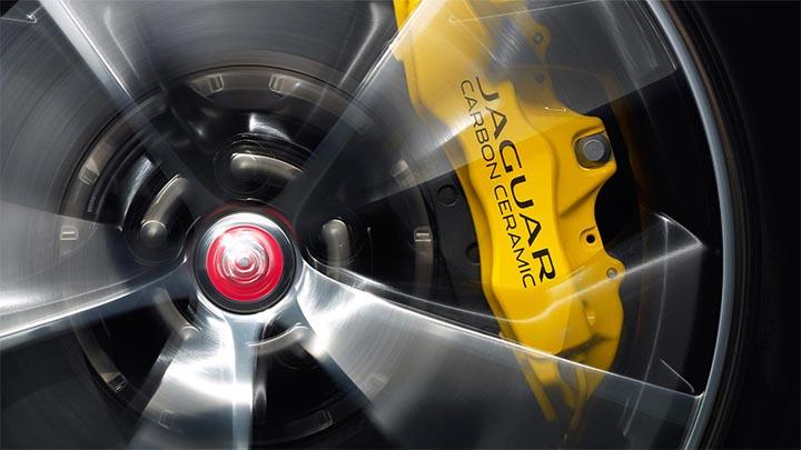 yellow Jaguar brake caliper behind alloy wheel