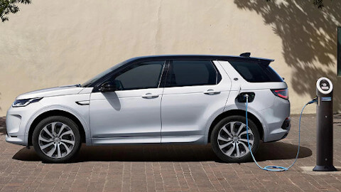 White Land Rover Discovery Sport Plug-In Hybrid Charging