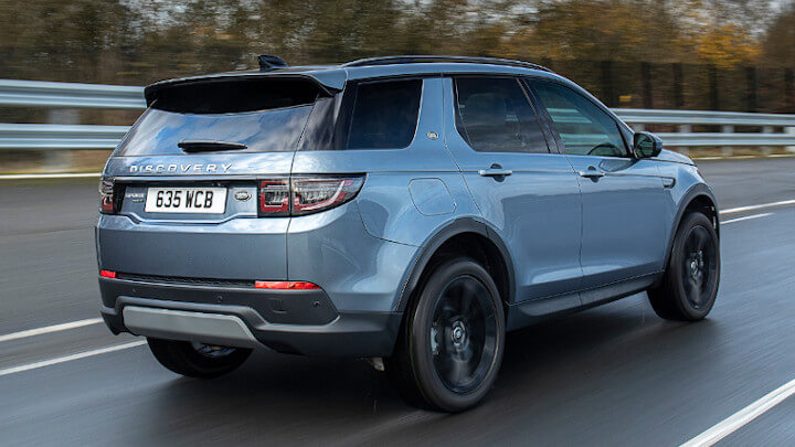 Blue Land Rover Discovery Sport Plug-In Hybrid Rear Driving