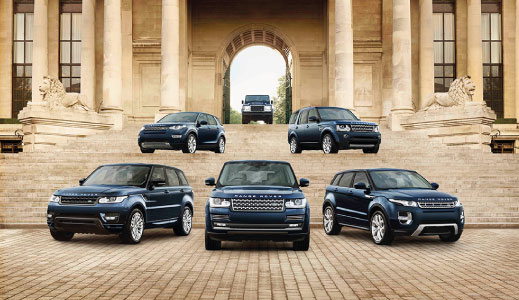 Six approved used Land Rovers on the steps.