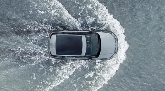 Land Rover driving through water.