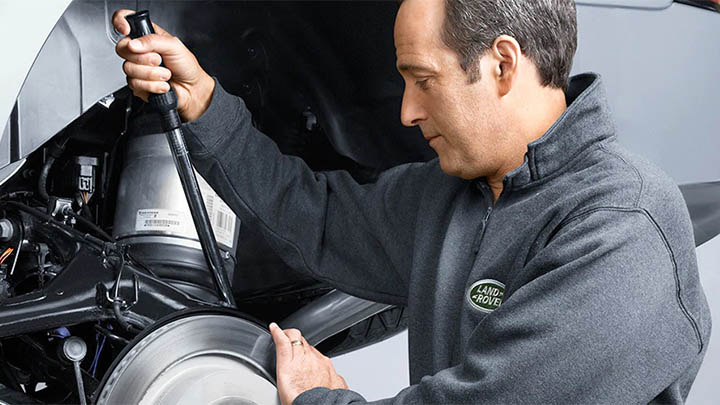 land rover technician completing brake repair