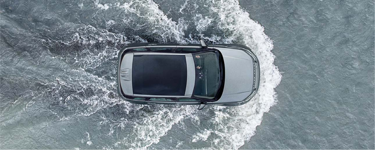 Land Rover driving in water.