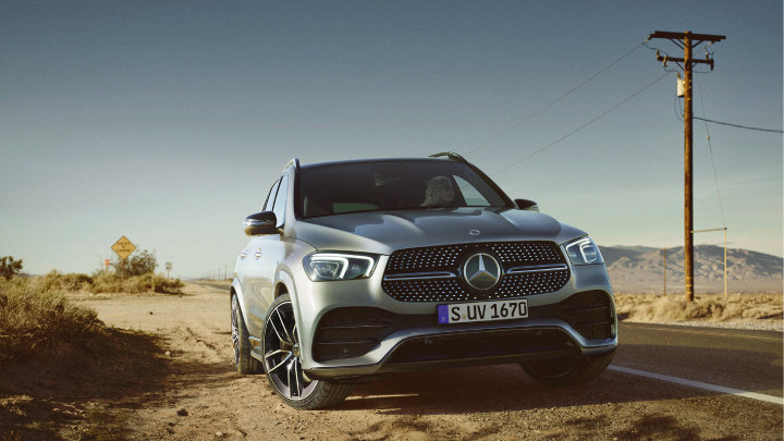 Mercedes-Benz GLE SUV parked on the side of the road.