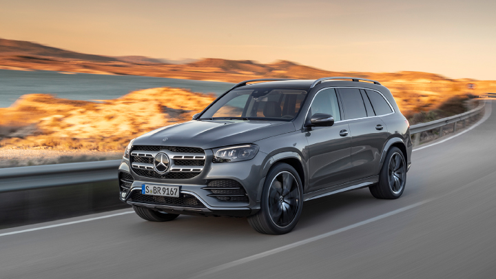 Grey Mercedes-Benz GLS driving on the road.