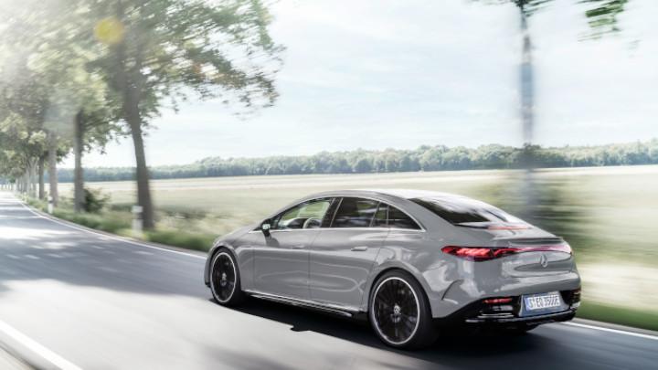 Grey Mercedes-Benz EQE Driving Rear