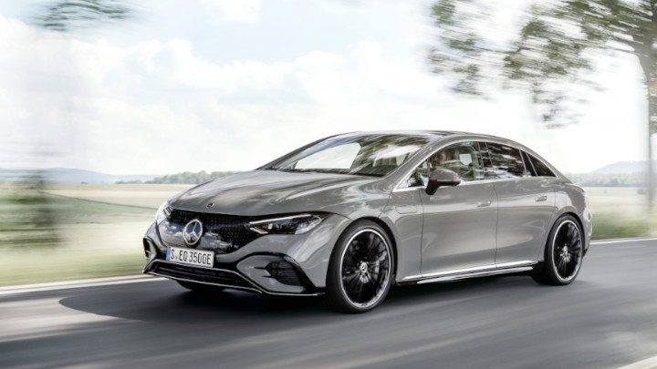 Grey Mercedes-Benz EQE Side Driving